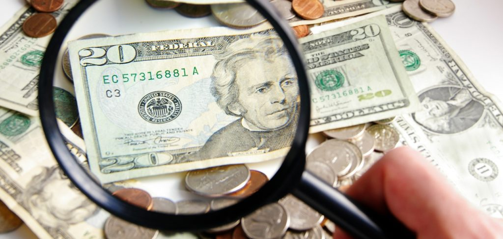 Magnifying glass over money shows DC can find more revenue for the DC budget