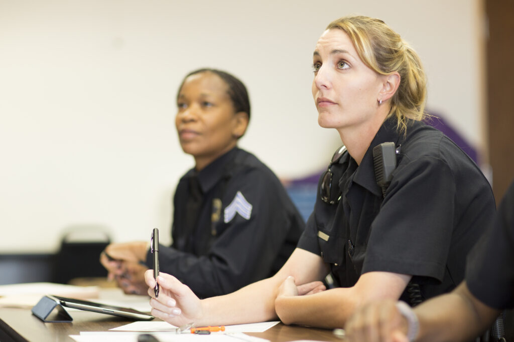 Policewomen in classroom