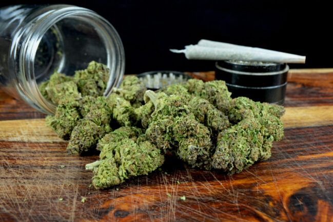 Photo of cannabis on a wooden desk